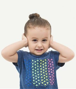a child covering her ears