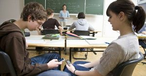 students using cell phones in class